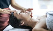 Massaging the head to induce a sense of wellbeing